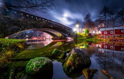 River bridge in night city. Bridge over river. River bridge night scene