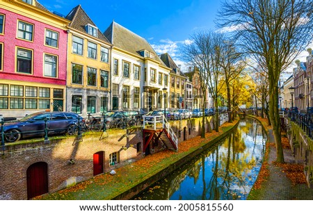 River channel in autumn city. City river in autumn. Autumn city river view