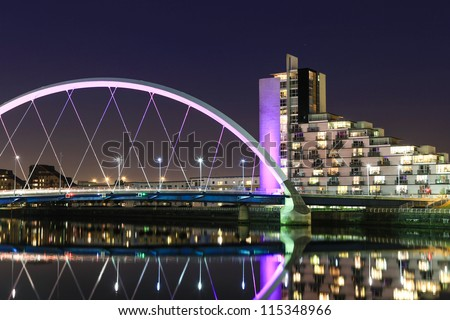 River Clyde, Glasgow at Night towards the Squinty Bridge. - stock photo