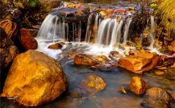 River creek waterfall rocks view. Waterfall rocks in creek water. Creek water waterfall rocks. Waterfall rocks view