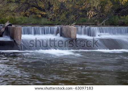 river dam diverting water for farmland irrigation, Cache la Poudre RIver in Fort Collins, Colorado, fall scenery