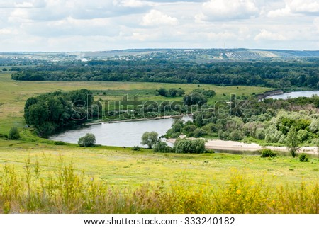 River Don in Voronezh region. Rural landscape. Meadows and fields, the village in the distance.