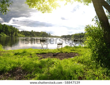 River Fishing place on lake under sky - stock photo