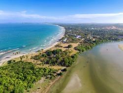 River flows into Back Bay of Indian Ocean near Nilaveli beach in Trincomalee, Sri Lanka.  Trincomalee is coastal resort city. Panoramic Top View on beach in Trincomalee.