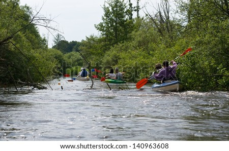 River fragment  with kayaks boats in water,European nature,river fragment close up, summer sport, wild river with trees and bushes, sport, sport activities, wild nature, Lithuania, kayak tour,boats
