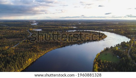 River in foliage forest, Aerial, tilt up, drone shot over a stream, in middle of autumn color forest, during golden hour, in Lappland, Swede Stock foto ©