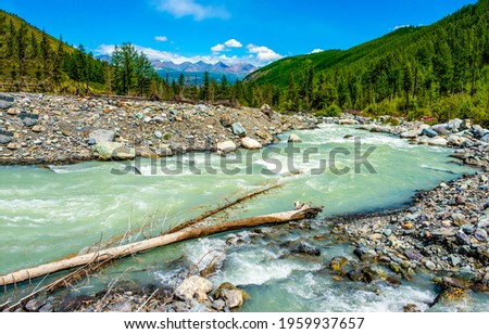 River in mountain valley landscape. River flow in mountain valley. Mountain valley river landscape