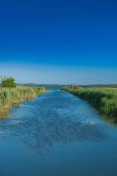 River in ornithological nature park Vrana lake (Vransko jezero) in Dalmatia, Croatia