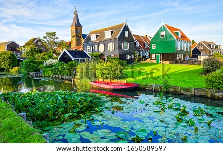 River in summer village. Housing on hill, rural meadow riverside view Stockfoto ©