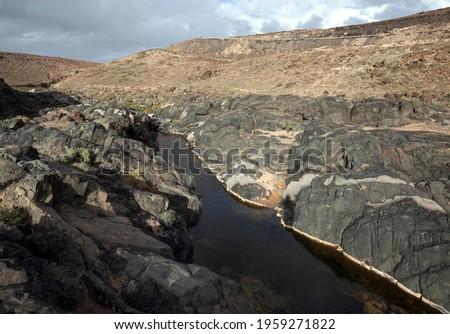 River in the Barranco de los Molinos, at Los Molinos, Fuerteventura, Canary Islands, Spain Foto stock ©