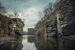 River in the canyon. Water between the rocks. An artificial lake in a flooded quarry.