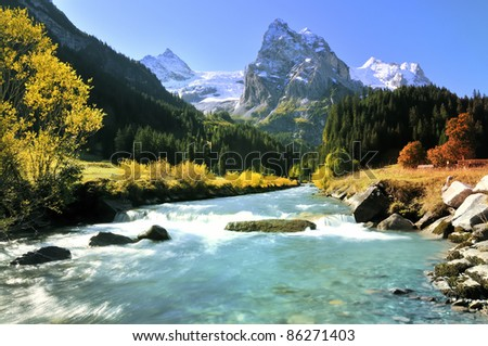 River in the Swiss Alps before impressive Mountains
