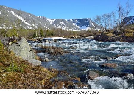 River Kuniyok in Khibiny in summer, Kola Peninsula, Russia #674373343