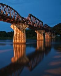 River Kwai railway bridge in sunset light.