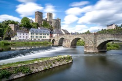 river Lahn in Runkel, Germany with old stone bridge and castle (taken with neutral-density filter)