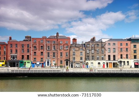 River Liffey and colorful buildings at summer day in Dublin, Ireland