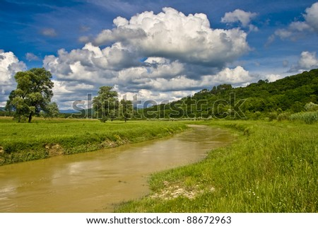 River Mirna after the rain with the clouds