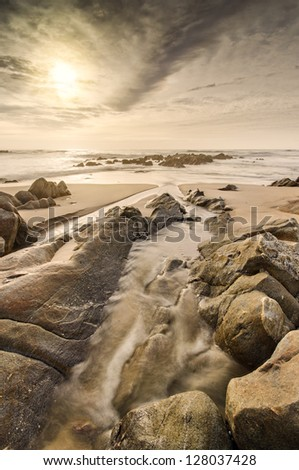 River mouth on the sea, beach scene with nice light