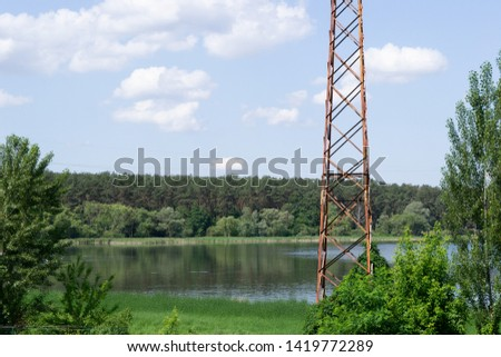 river near the forest. iron pillar #1419772289