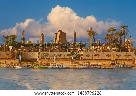 "River Nile Luxor Egypt,  ""Business card"" of a beautiful tourist city on the background of the sunset evening sky. #1488796226"
