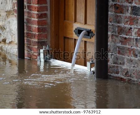 River Ouse overflows into nearby street. York, UK. - stock photo