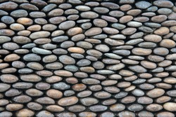 River Pebble Wall Background, Rock river Stones arranged for texture wallpaper.