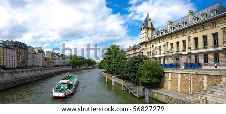 River seine with water bus and famous quay des Orfe`vres in Paris where the judicial police
