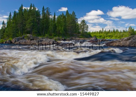 river stream running over the rapids
