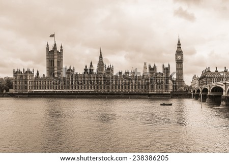 River Thames and Palace of Westminster (known as Houses of Parliament). Palace of Westminster located on bank of River Thames in City of Westminster, London. Vintage sepia photo.