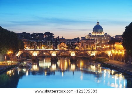 River Tiber in Rome - Italy at night .