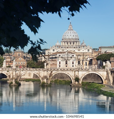 River Tiber, Ponte Sant Angelo and St. Peter's Basilica in the background.