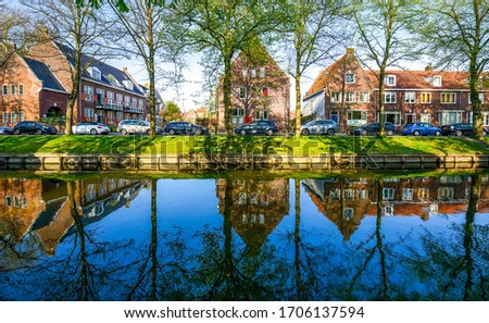 River town houses view. River town houses reflection in water