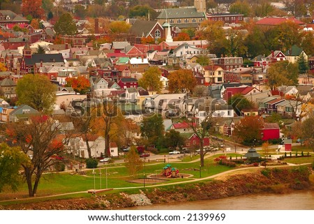 River Town USA - Aerial view of autumn in a small Kentucky river town along the muddy Ohio River.