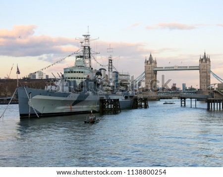 River view of the HMS Belfast, with the Tower Bridge in the background, London, March 2018.
