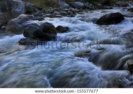 River water flowing through rocks at dusk, Reshi River, Reshikhola, Sikkim