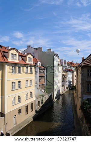 River with buildings in Prague, Czech Republic.