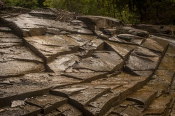 Riverbed rocks in the summer, when the water is low. Image is from a glacial gorge in the New York State Finger Lakes.