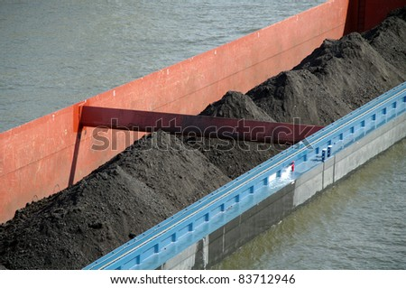 Riverboat fragment with coal