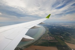 Rivers. lakes, valleys, fields from above. Panoramic view from an airplane window. Cloudy blue sky. Landscape, cloudscape. Transportation, passengers, tourism, travel destinations, wanderlust