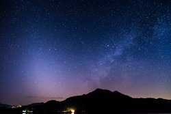 Rivers, mountain stars, zodiacal light and the Milky Way on a beautiful blue night in New Day.
