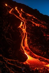 Rivers of lava flowing down a hill