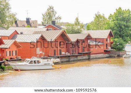 riverside storage houses and museums in picturesque medieval old town of Porvoo, second oldest town in Finland, with many red-colored wooden houses