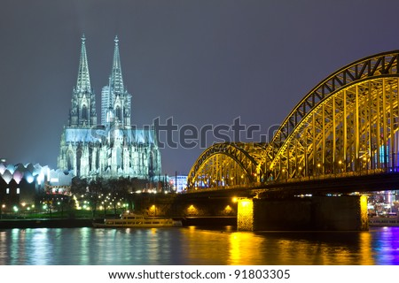Riverside view of the Cologne Cathedral and railway bridge over the Rhine river, Germany