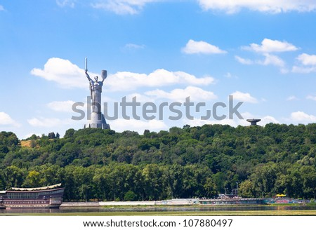 riverside view on monument of Mother of the Fatherland from Dnieper River in Kiev, Ukraine