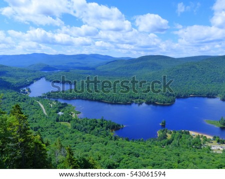 Rivière rouge, Mont Tremblant National Park, Laurentian Mountains, Quebec (close to Montreal), Canada. 19 July 2015. Canadian wilderness and beautiful landscape with cloudy sky. mostly green and blue #543061594