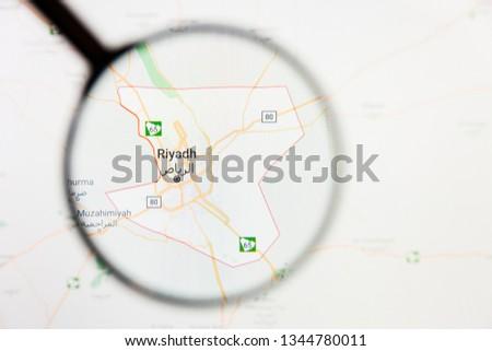 Riyadh, Saudi Arabia city visualization illustrative concept on display screen through magnifying glass #1344780011