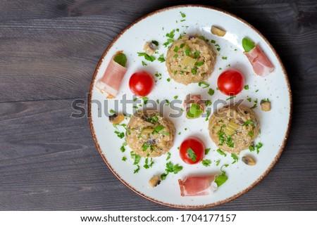 Rizotto cherry tomoatoes jamon basilico Stock fotó ©