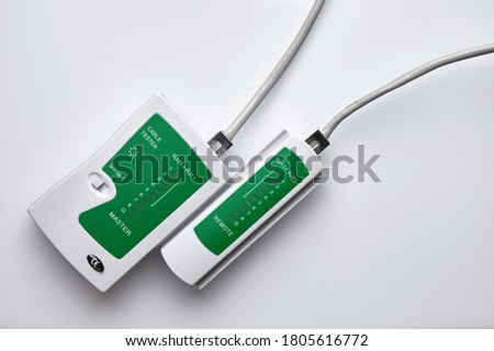 RJ45 cable network tester. Twisted pair test tool. Сток-фото ©