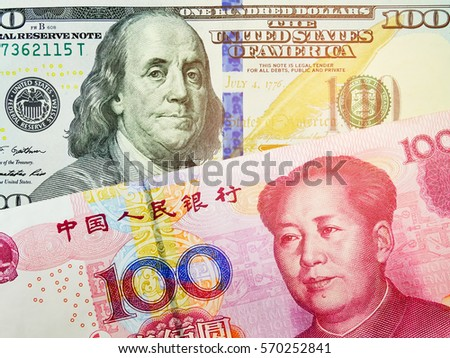 RMB and US dollar bank notes concept business background. Close up view of US Dollar and Chinese yuan bills. currency exchange rate. Background with money american dollar and Chinese yuan  banknote #570252841