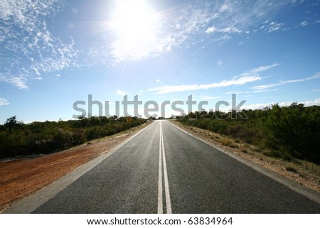 Road ahead with bright spot of sunshine